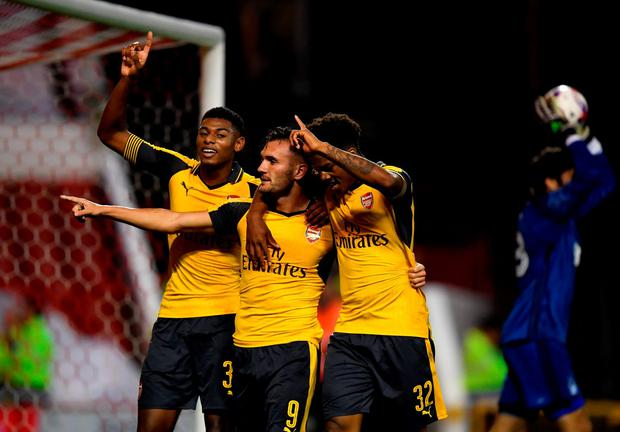 Lucas Perez (C) celebrates scoring Arsenal's third goal with Jeff Reine-Adelaide (L) and Chuba Akpom. Photo: Getty