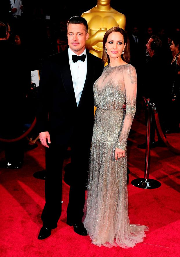 Brad Pitt and Angelina Jolie at the Oscars in 2014. Photo: PA