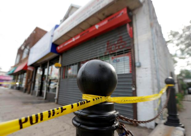 A police perimeter ioutside the First American Fried Chicken restaurant in Elizabeth, N.J. The Elizabeth establishment and the apartment above are tied to Ahmad Khan Rahami, who was arrested as a suspect in the weekend bombings in New York and New Jersey. Photo: AP