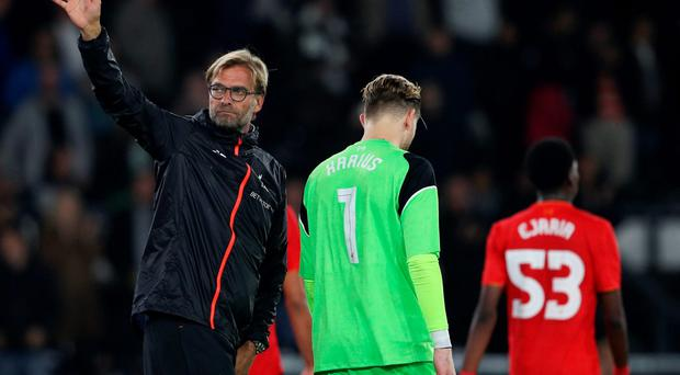 Liverpool manager Juergen Klopp waves to fans at the end of the match