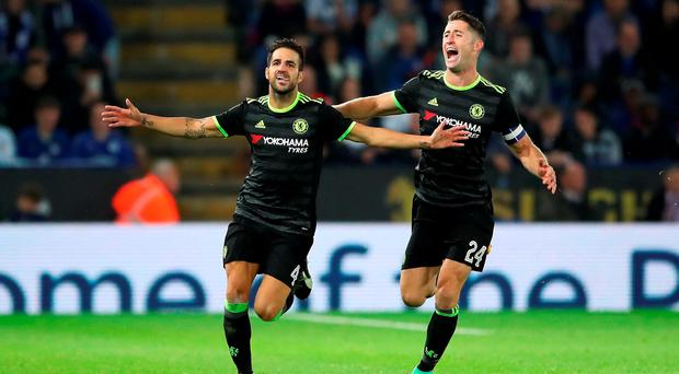 Chelsea's Cesc Fabregas (left) celebrates scoring his side's fourth goal