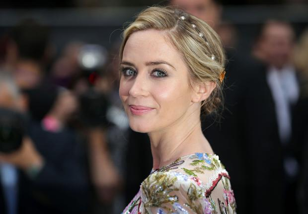 British actress Emily Blunt poses for photographers as she arrives to attend the World Premiere of the film 'The Girl on the Train', in central London on September 20, 2016. / AFP / DANIEL LEAL-OLIVAS (Photo credit: DANIEL LEAL-OLIVAS/AFP/Getty Images)