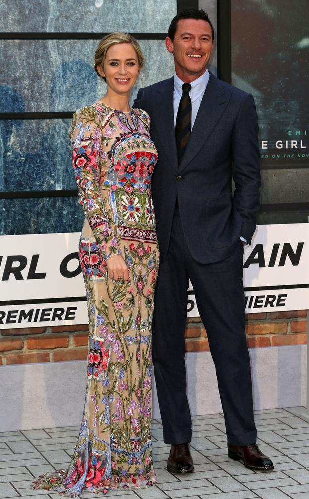 British actress Emily Blunt (L) and British actor Luke Evans pose for photographers as they arrive to attend the World Premiere of the film 'The Girl on the Train', in central London on September 20, 2016. / AFP / DANIEL LEAL-OLIVAS (Photo credit: DANIEL LEAL-OLIVAS/AFP/Getty Images)