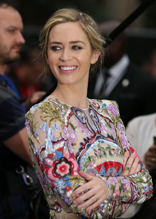 British actress Emily Blunt smiles as she arrives to attend the World Premiere of the film 'The Girl on the Train', in central London on September 20, 2016. / AFP / DANIEL LEAL-OLIVAS (Photo credit: DANIEL LEAL-OLIVAS/AFP/Getty Images)