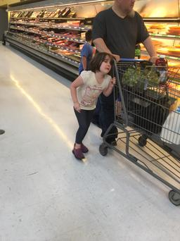 Erika Burch posts a picture on Facebook of a father pulling his daughter's hair in Walmart in hopes that it would go viral. (ERIKA BURCH/FACEBOOK)