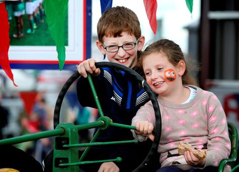 Brendan Rice (11) from Shannonbridge and Emily Heffernan (8) from Tullamore take a closer look at a vintage John Deere tractor Picture; Gerry Mooney.