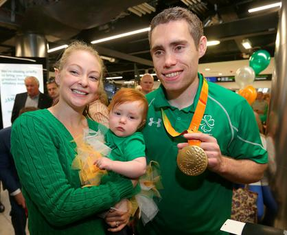 Jason Smyth, with his daughter, Evie and wife Elise arrives back to Dublin airport. Photo: Damien Eagers