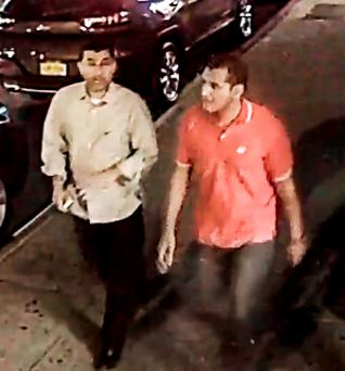 Two unidentified men walking in the Chelsea neighborhood of New York on Saturday. (FBI via AP)