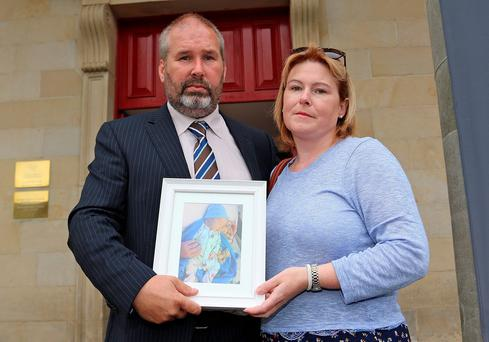 Siobhan and Andrew Whelan at Cavan Courthouse with a picture of their son Conor. Photo: Teevan Photography