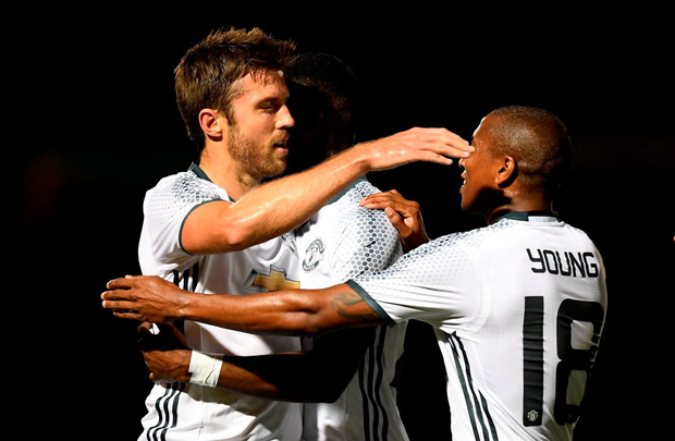 Michael Carrick of Manchester United celebrates scoring his sides first goal with team mates during the EFL Cup Third Round match against Northampton Town. (Photo by Shaun Botterill/Getty Images)