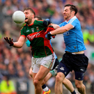Mayo's Aidan O'Shea in action against Dublin's Michael Darragh Macauley during the GAA Football All-Ireland Senior Championship Final match between Dublin and Mayo at Croke Park in Dublin. Photo by Eóin Noonan/Sportsfile