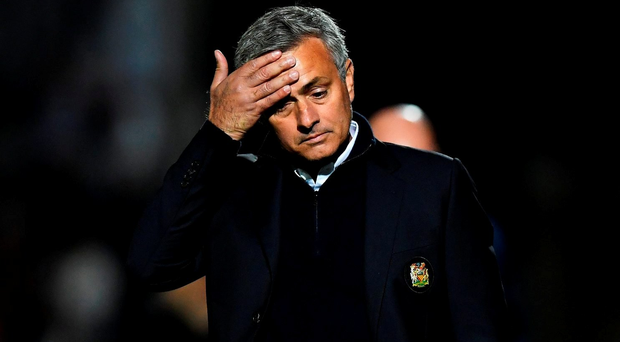 Jose Mourinho looks dejected during the EFL Cup Third Round match between Northampton Town and Manchester United. (Photo by Shaun Botterill/Getty Images)