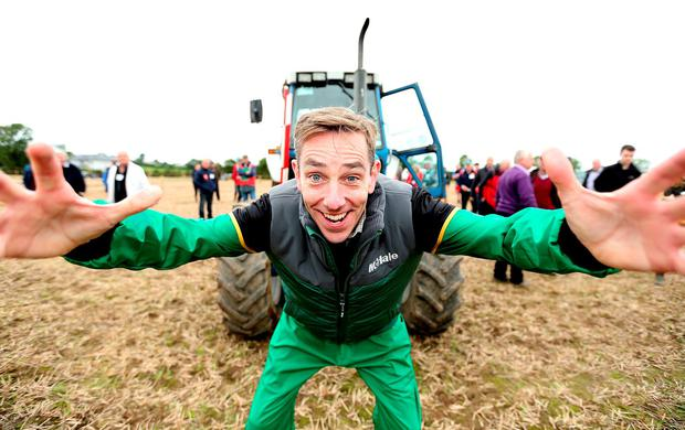 RTÉ's Ryan Tubridy hopped into a tractor to plough his first furrow at the Ploughing Show in Tullamore, which drew a crowd of 111,000. Photo: Gerry Mooney