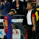 Barcelona's Lionel Messi leaves the pitch next to coach Luis Enrique. Photo: Reuters