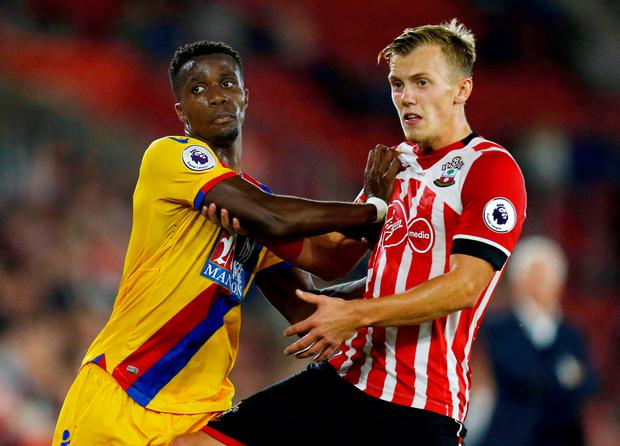Southampton's James Ward-Prowse (right) and Crystal Palace's Wilfried Zaha tussle for space. Photo: PA