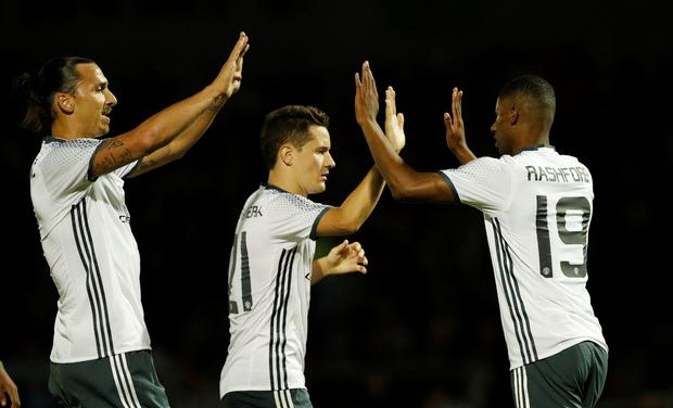 Manchester United's Marcus Rashford celebrates scoring his side's third goal with Zlatan Ibrahimovic and Ander Herrera. Photo: Reuters