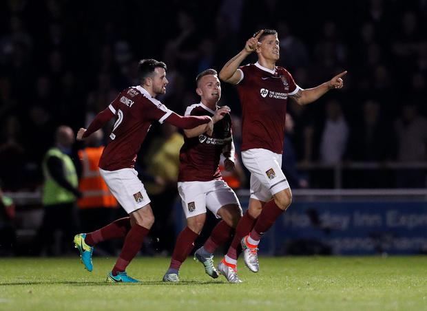Northampton Town's Alex Revell celebrates scoring his side's only goal with team mates. Photo: Reuters