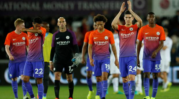 Manchester City's John Stones applauds fans after the game. Photo: Reuters