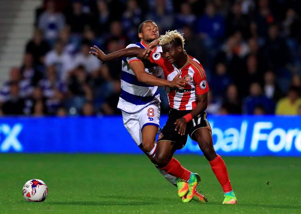 Sunderland's Didier Ndong (right) and Queens Park Rangers' Jordan Cousins battle for the ball. Photo: PA