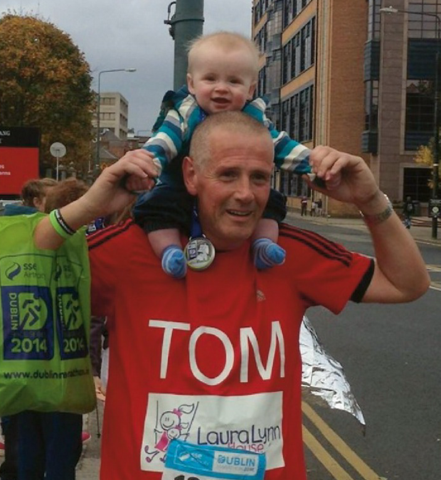 Tom, pictured with his grandson as they ran the last 500metres of the Dublin Marathon together