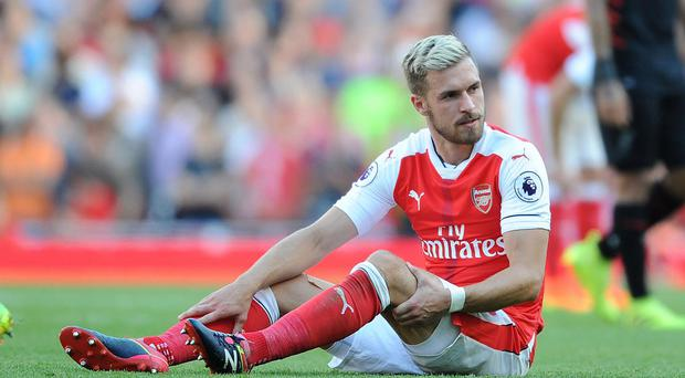 Aaron Ramsey is not recovering from his hamstring injury as quickly as Arsenal expected. Getty