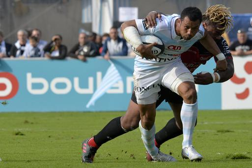 Casey Laulala of Racing Metro 92 battles through a tackle by Mathieu Bastareaud of Racing Club de Toulon during their Top 14 match in Colombes, France. Photo by Aurelien Meunier/Getty Images