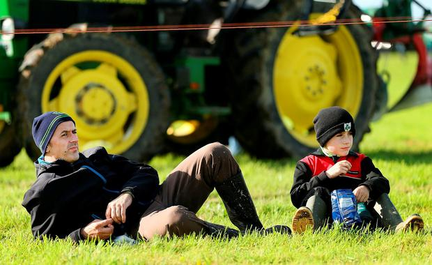 Seamus and Edward Dunne (9) from Kildalkey, Co Meath, taking a break. Photo: Gerry Mooney