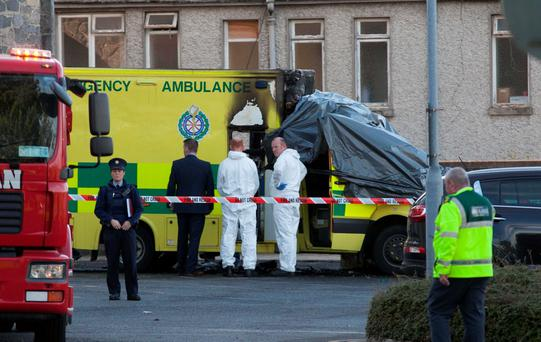 Members of the emergency services examine the ambulance following the devastating fire at Naas General Hospital. Photo: Gareth Chaney/Collins