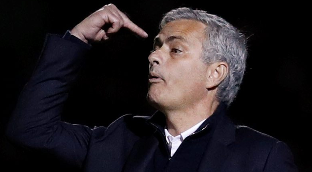 Jose Mourinho gives instructions to his players during their win over Northampton. Picture: Reuters