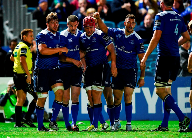 Jonathan Sexton is congratulated by team-mate Jordi Murphy, Josh van der Flier and Zane Kirchner after scoring his side's third try against the Ospreys. Photo by Ramsey Cardy/Sportsfile