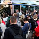 Commuters queue for a packed Luas service. Photo: Steve Humphreys