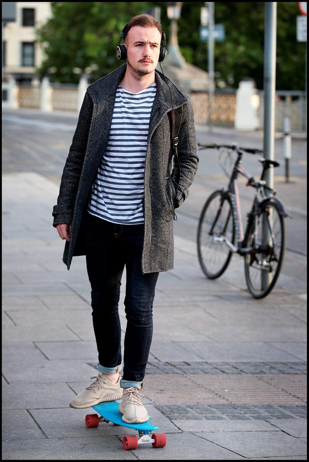 Daniel O'Farrell uses a skateboard to make his way from Heuston Station yesterday. Photo: Steve Humphreys