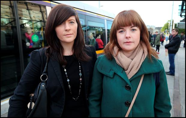 Frustrated commuters Gemma Lawlor and Arlene Foy, both from Portarlington, wait for a Luas. Photo: Steve Humphreys