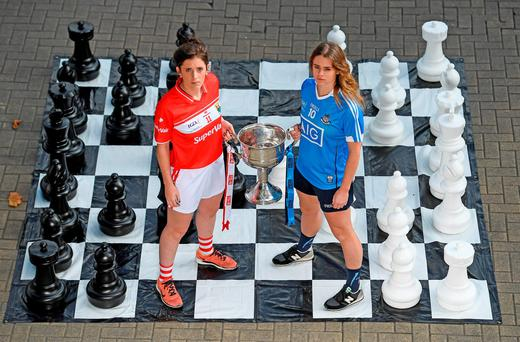Ciara O'Sullivan of Cork and Dublin's Noelle Healy with the Brendan Martin Cup which will be up for grabs when the two sides clash at Croke Park tomorrow Photo by Brendan Moran/Sportsfile
