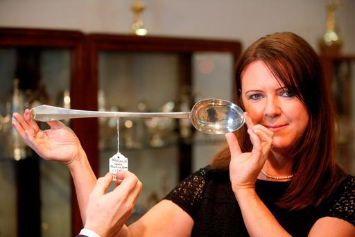Cressida Fallon from JW Weldon with a silver spoon worth €45,000. Picture: Conor McCabe