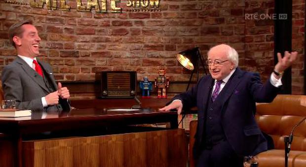 Ryan Tubridy laughs as President Michael D Higgins describes his skills as a silver service waiter