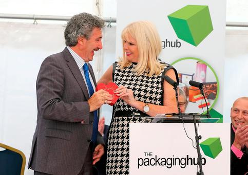 Mary Mitchell O'Connor presenting John Halligan with a Fortnum and Mason heart- shaped box at the opening of The Packaging Hub in Waterford. Photo: Noel Browne