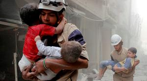 Members of the civil defence rescue children after an air strike in the al-Shaar area of Aleppo in Syria. Photo: Reuters