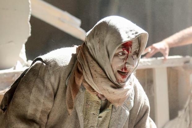 An injured woman after an air strike in Syria. Photo: Reuters