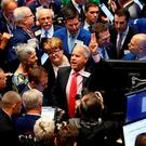 Traders and Executives from Valvoline Inc. await the first trade during the company's IPO on the floor of the New York Stock Exchange