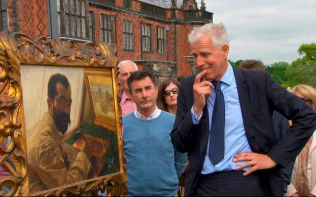 Antiques Roadshow pictures expert Rupert Maas examines the painting Credit: BBC