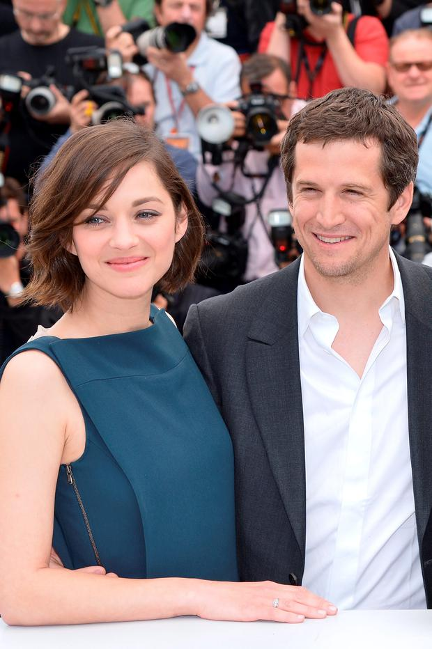 French actress Marion Cotillard (L) and director Guillaume Canet pose on May 20, 2013 during a photocall for the film