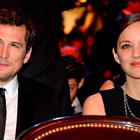 French actress Marion Cotillard (R) and her partner French actor Guillaume Canet attend the 40th edition of the Cesar Awards ceremony