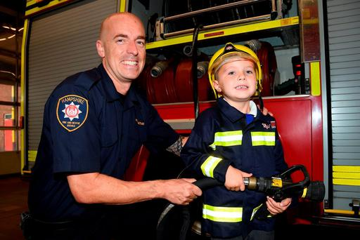 Hampshire Fire and Rescue Service undated handout photo of firefighter Mark Hair with Jack Whitmore at Southsea Fire Station whose grandmother, Frances Crouch, with a fear of heights has thanked the