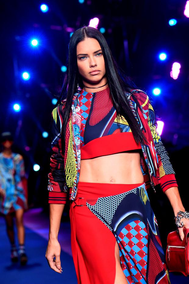 Adriana Lima presents a creation for fashion house Versace during the 2017 Women's Spring / Summer collections shows at Milan Fashion Week