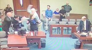 Harding tries to lunge at the prosecutor Jonathan Roth