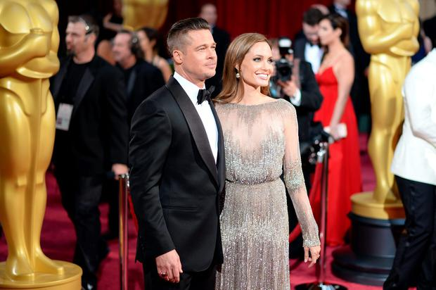 Actors Brad Pitt and Angelina Jolie attend the Oscars held at Hollywood & Highland Center on March 2, 2014 in Hollywood, California. (Photo by Michael Buckner/Getty Images)