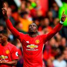 Paul Pogba of Manchester United celebrates scoring his side's fourth goal