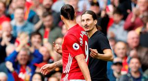 Manchester United's Zlatan Ibrahimovic as a fan invades the pitch Action Images via Reuters / Carl Recine