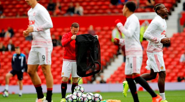 Manchester United's Wayne Rooney warms up before the match Reuters / Darren Staples